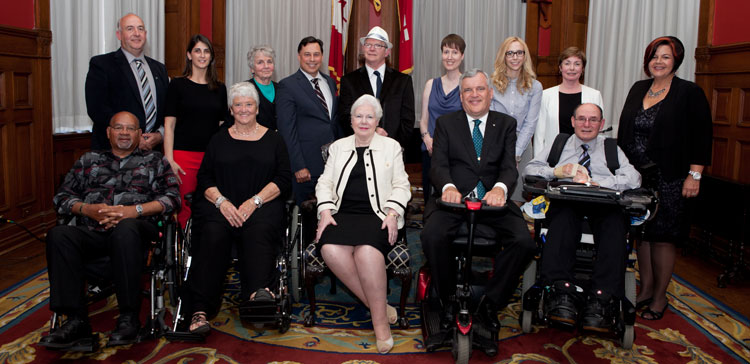 Back L-R: Jeremy Williams (Mayor of Orangeville), Joanne Jordan (Access Orangeville), Diva Anderson (Access Orangeville), the Honourable Brad Duguid, Minister of Economic Development, Employment and Infrastructure, Michael Gravelle (Access Orangeville), Sarah Murray (Access Orangeville), Sarah Dinsdale, Kathryn Church, Lois Davies. Front L-R: Hubert Peter Roy (Access Orangeville), Gail Campbell (Access Orangeville), Her Honour the Honourable Elizabeth Dowdeswell, Lieutenant Governor of Ontario, the Honourable David C. Onley, Special Advisor to the Minister on Accessibility and Honourary Chair, 10th Anniversary of the Accessibility for Ontarians with Disabilities Act, Larry Rankin (Access Orangeville).